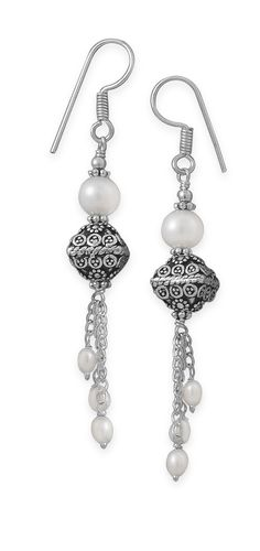 Cultured freshwater pearl and ornate lantern style bead drop french wire earrings. The cultured freshwater pearl measures approximately 7.7mm, lantern bead is 10.7mm x 11mm and the three small pearls