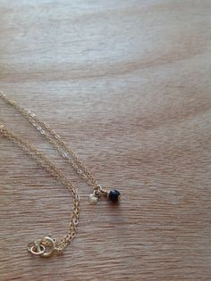 Single tiny Onyx bead and 14k Gold Filled heart Charm on a 14k Gold Filled chain.
