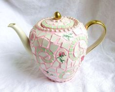This delecate shabby chic tea pot was made out of several old china plates and one beautifully shaped vintage tea pot