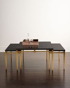 "The gold flecks on the black surface are flying geese! ""Marla"" coffee table from the John-Richard Collection."