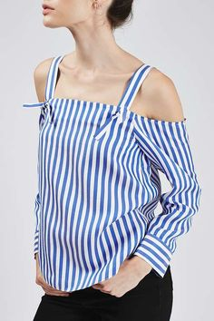 Opt for a chic finish with this off-the-shoulder style shirt by Boutique. A flattering, easy to wear silhouette with a cami strap detail, it comes crafted with classic shirt sleeve cuff and tie details to the shoulder.