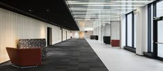 LEMAYMICHAUD | Quebec | Conference Hall | Architecture | Design | Seating | Carpet | Windows | Natural Light | Black | Gray | Red | White