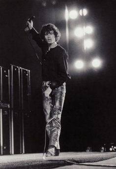 Jim Morrison of The Doors doing his Lizard King thing on stage