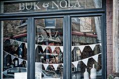 Gorgeous window at Buk + Nola Shop Front Design, Secret Places, White Ceramics, Good Times, Color Schemes, Arts And Crafts, Shop Windows, Buntings, Inspiration