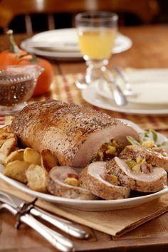 Apple and Cornbread-Stuffed Pork Loin with Roasted Apple Gravy:  Another delicious turkey alternative for your Thanksgiving get together.