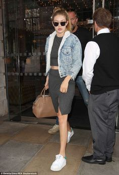 Looking leggy: Gigi wore trainers with her skirt and matching crop top on Wednesday...