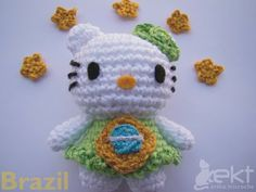 Hello Kitty Amigurumi - Free Pattern (Website is in Portuguese, use a translation service)