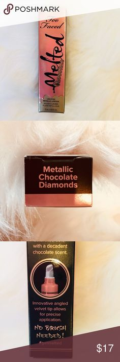 NIB Too Faced Melted Metallic Lipstick Chocolate NIB Too Faced Melted Metallic Lipstick Chocolate. Brand New in the box. Never been opened. Metallic, liquid lipstick with high impact color. 0.04Fl oz. Decadent chocolate scent. No brush needed! Angled velvet tip allows for precise application. Please ask questions before buying. Thank you. Too Faced Makeup Lipstick