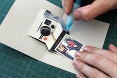 love the idea of a polaroid camera with a little pull out picture as a card