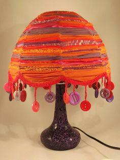 Strips of fabric tied to wire lampshade frame i could make that one of a kind upcycled lampshade in vibrant colours with button fringe greentooth Gallery