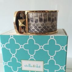 FLASH SALE NIB Stella & Dot Leather snake bangle NIB S&D Bello Bangle. Discontinued and sold out!! Genuine leather set in gold plated metal with Czech crystal and pyramid studs unite harmoniously in this luxe bangle. Magnet closure. Genuine leather, each one is unique and will vary from piece to piece!! Fits S-L wrists. Stella & Dot Jewelry