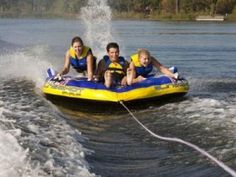 Water Tubing... did this on lake erie and on tappan lake with my dad.. best time was when junior fell off and thought we were leaving him he was yelling shark shark... we were just turning boat around!!! ha ha