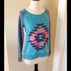 "NEW! RQT Top New with tag. Size small but more like a medium. Measurements arm pit to arm pit is about 18"". Length from shoulder to end is 24 1/2"" to 25"". Sweatshirt like. 60% cotton, 40% polyester, wash inside out. RQT Tops"