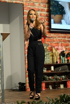 45feaa0334096 Newlywed Katie Piper shows off her model figure in black jumpsuit
