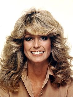 Farrah Fawcett hair, I was looking at old pic's the other day and found me sporting this hairdo, my hubby just had to laugh! I thought I looked pretty good back in the day!