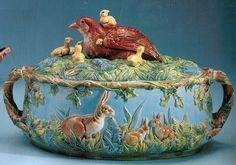 majolica. This casserole dish, also by George Jones & Sons from 1880 features an elaborate but placid forest scene, complete with rabbits and a nesting dove, which doubles as the lid's handle.