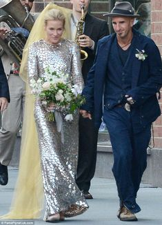 Shining bride: Piper Perabo went against tradition by wearing a shimmering silver giraffe print dress for her wedding this weekend, but it's...