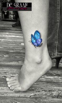 Realistic butterfly, tattoo by @De Graaf Tattoo
