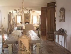 French Provence Decor designed by ELise Valdorcia.  Decor french country. Love the farm table and double french wooden doors