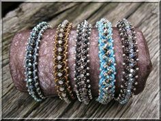Love these bracelets. It's actually bead embellished macramé. New URL with free tutorial.