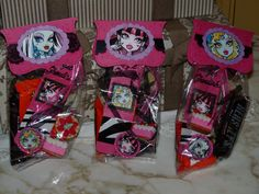 Monster High Goody bags containing handmade bookmark, bottlecap necklace, and other ghoulish loot.