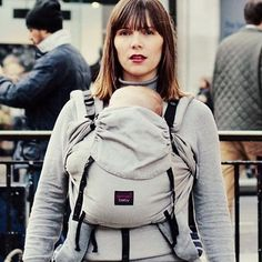Looking for a baby carrier that will last your baby from newborn to toddler and will give you a custom comfortable fit every time? . Meet the Emeibaby carrier. A unique wrap/sling meets soft structured carrier design that literally hugs baby against your body when adjusted. Safe comfortable and stylish  .  @emeibaby . . . . [image of a white woman wearing a baby in a grey baby carrier. The carrier is called an Emeibaby carrier. She is pictured walking in a built in area with people in the…