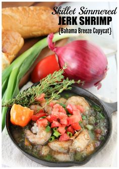 This Bahama Breeze copycat fire roasted jerk shrimp dish is simmered in a delicious garlic-thyme butter and is served with French bread