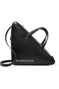 Balenciaga's triangle-shaped 'Duffle' tote is based on retro ski boot bags. Made in Italy, this structured style is cut from smooth black leather, stamped with a white logo and has a spacious red interior that will hold your tablet, cosmetics pouch and wallet. Carry it cross-body using the detachable shoulder strap.