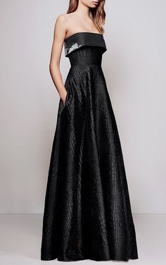 This **Alex Perry** gown features a strapless foldover bodice and allover silk reptile print.