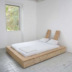 "Katrin Arens has been designing furniture out of reclaimed, ""abused wood"" since 1998 out of her home, a converted century mill in Bergamo, Italy. We recently noticed her handmade wood slatted bed frame and a mattress filled with virgin wool and cotton. Home Bedroom, Bedroom Furniture, Home Furniture, Furniture Design, Bedroom Decor, Bedrooms, Wooden Furniture, Reclaimed Wood Bed Frame, Creative Beds"