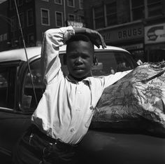 Vivian Maier Untitled (Child Leaning on Car), Maxwell Street Marke and skid row on Wst Madison Street in Chicago, 1967, 1967