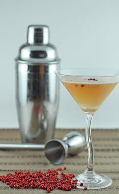 Tokyo Manhattan: (Makes 2)  3.5 oz. Bourbon, 1 tsp honey, 2 oz. cranberry juice, crushed pink peppercorns for garnish (optional)