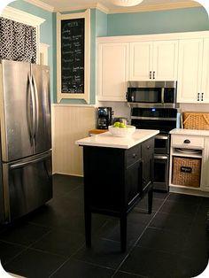 So many ideas-- take off cabinet door -- add basket. Chalkboard, curtain above fridge to hide... stuff :)