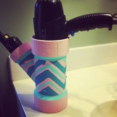 Hair dryer and straightener holder. Make it from home! 1 PVC pipe joint. Your choice of paint and design. I chose chevron with a pinstripe. Great for keeping your bathroom or vanity organized and looking adorable!
