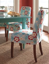 Turquoise table and slipcovered chair