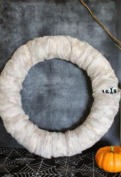 10 Best DIY Halloween Wreaths. Glow in the dark eyeball wreath!