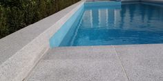 Ash Flamed Graite paving tiles and pool coping