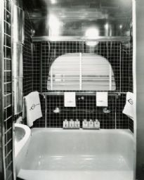 """Jungle Yacht"" Bathroom  Description: 	Bathroom of an International ""Jungle Yacht"", complete with his and her toiletries and towels embroidered with the letter ""G"" for Gatti. International Harvester produced custom-built trucks called ""Jungle Yachts"" for Commander Attilio Gatti's tenth expedition to the African Congo."