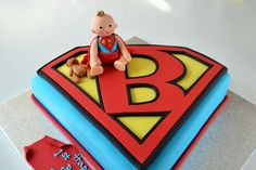 Super baby cake - This cute baby is Ben. Isnt he adorable with his superman outfit !