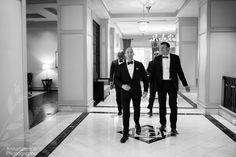 Groom walking through the Grand Hyatt with his groomsmen