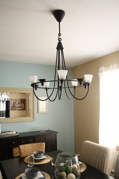 IKEA light fixture - fell in love love with this for my dining room.  Romantic & somewhat goth.