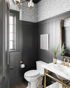 Decadent powder room with wide vertical shiplap and Cole & Son Columbus wallpaper   by Cortney Bishop Design