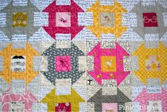 There are so many amazing elements in this Churn Dash quilt. Fussy cut middles, bright outsides and the use of text fabric which is very popular right now!  Original Artist: http://pinkxstitches.blogspot.com/2013/05/texty-churn-dash-quilt.html