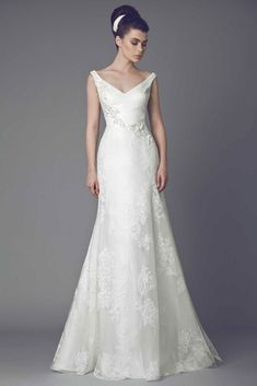 Capucine - Silk Gazar A line gown with V neckline and delicate embroideries on the bust.