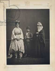 The Ottoman Empire, studio portrait of models wearing traditional clothing from Istanbul, Turkish woman of Constantinople wearing indoor dress, Turkish schoolboy, Turkish woman of Constantinople wearing an outdoor dress, photograph by Pascal Sebah, 1873