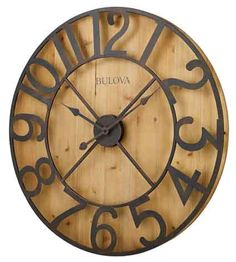 """<p> The Bulova Barnboard large wall clock has a knotty pine veneer finished in natural pine stain. This clock will be a feature point in any home decor. The offset aged metal Arabic numerals create depth and allow for natural back lighting. Requires (1) AA battery, not included. One year warranty and Free Shipping.</p> <p> Size : Dia.: 28.75"""" D..."""