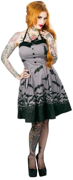 Add a little scare to your wear with the Bats Spooksville Dress! This gray, figure flattering halter dress features a black bat pattern, fitted bodice with black trim & faux buttons that goes into a full skirted bottom. •Made by Sourpuss •95% Cotton/5% Spandex  ***Pre-Order to secure your dre...