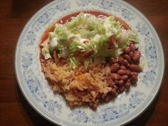 Carne asada wet burrito w/lettuce, tomato,chives, sour cream on top. sides rice & beans