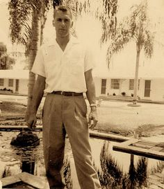 """Dad, on a trip we took to explore Florida. I think it was at a motel in Lake Wales. We visited """"Spook Hill"""" and the """"Bok Tower"""" - tourist destinations. Everything in Florida seemed so exotic so florid. Obviously he was hooked.  He looks so young and slender in this photo. And so he was."""