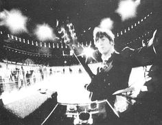 This photo was taken by John Lennon at The Beatles' last live public performance at Candlestick Park on the 29th August 1966.  Only the band themselves knew it was going to be their last show, and as something to remember it by, John Lennon and Paul McCartney took a camera to the stage with them where they took photos of the crowd, the rest of the band and themselves at arm's length.